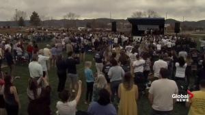 Teacher leads chants of 'We Are Columbine' during ceremony